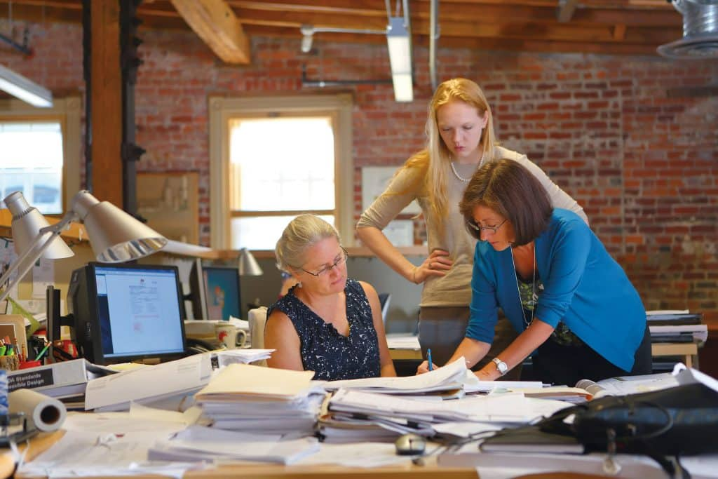 Lori Snyder '79 Garrett, right, collaborates with colleagues at Glavé and Holmes Architecture. Photo courtesy of G&H.
