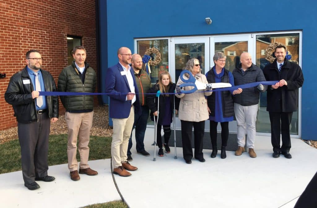 Elementary building celebration. Left to right: Mike Stoltzfus, director of business affairs; Wayne Witmer, Harman Construction; Jeff Shank, EMS board chair; Charles Hendricks, Gaines Group Architects; Marlowe Nichols '27; Maria Archer, K-8 principal; Teresa Anders, board of trustees; Frank Oncken, Chamber of Commerce; Paul Leaman, head of school.