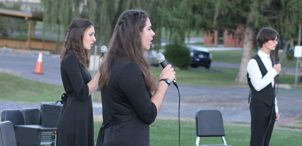Touring Choir sang outdoors for parents, faculty and staff one time in fall 2020. The usual process and cycle of choirs was adjusted due to COVID.