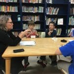Maria Archer, K8 principal uses a talking piece with 6th grade boys' Neighbor Group.