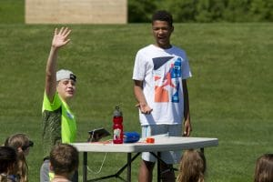 Older students help out at the elementary school's annual field day