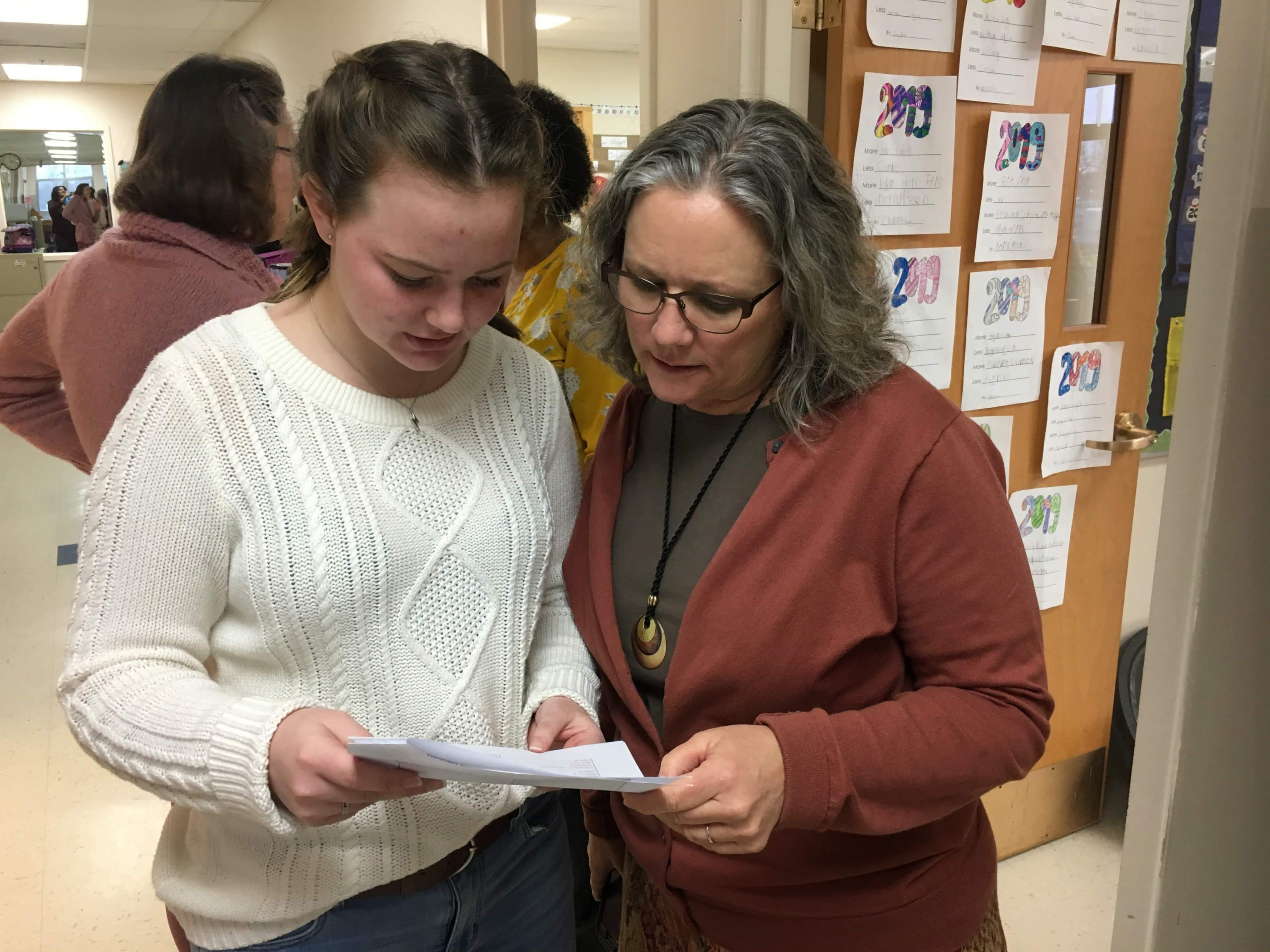 Mrs. Maria Archer, K-8 principal, and a student leader collaborate.