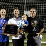 Curt Stutzman, Andrew Gascho, Forrest and Dave Bechler with the state championship plaque for girls soccer, 2015