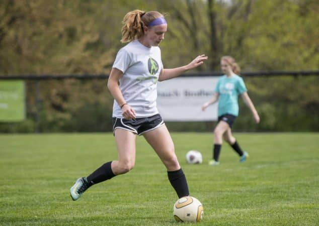 Junior forward Abby Stapleton '20, passes the ball during practice on April 24, 2019. Daniel Lin/DN-R
