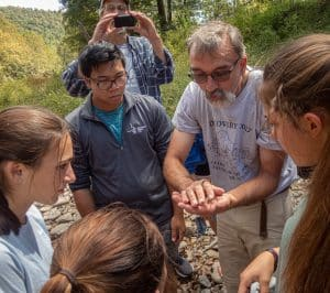 Science teacher Lee Good with environmental science students exploring the North Fork. Photo by Steven Johnson.