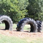 Eighth grade science class works on EMES playground tire project.