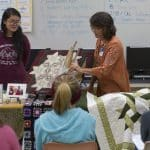 Learning about quilts from area experts on History Day for the centennial quilt project