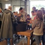 Sixth graders at fish hatchery