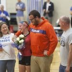 Joshua Stapleton '18, surprised is sister Abby '20, for senior day