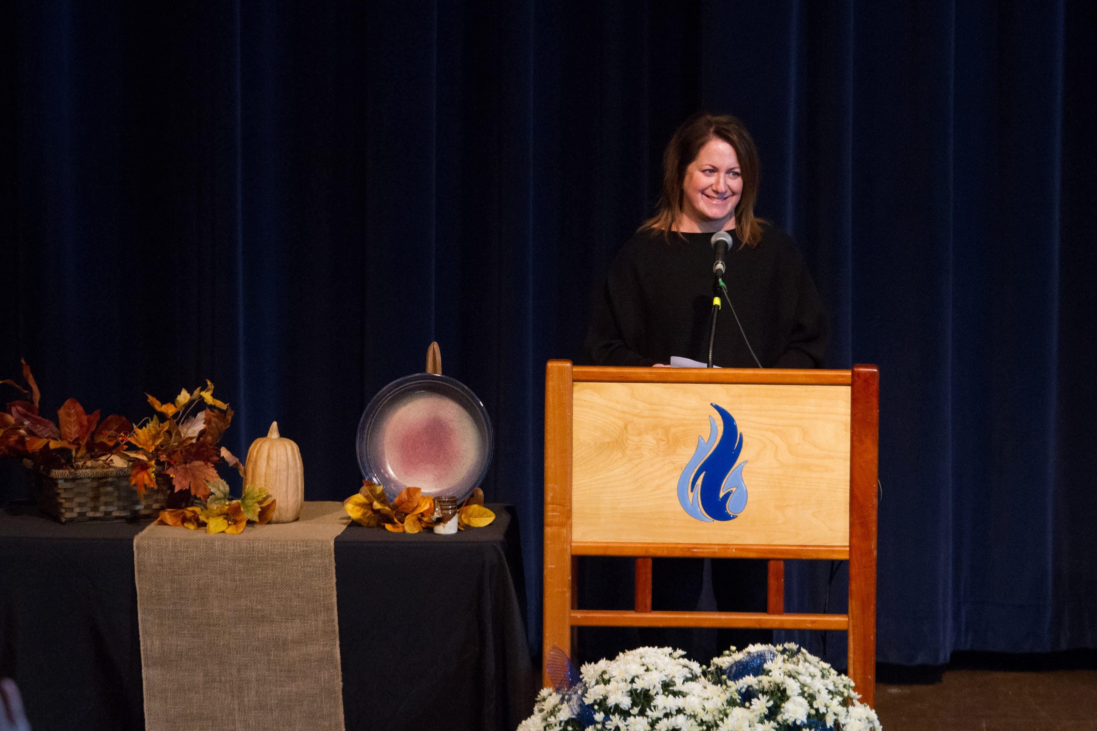 Kirsten Nafziger Moore, Community Engagement Awardee, speaking in chapel