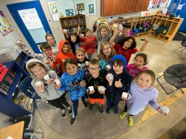 Photo by Bethany Gibbs of her fourth grade classroom as they first unpacked their Sphero Bolts, winter 2020