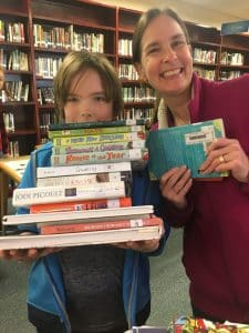 Lauren Barker and Jackson Comfort share their book recommendations while stocking up at the EMS library on March 17