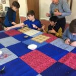 Seventh grade class. Comforter knotting for Mennonite Central Committee at Virginia Mennonite Retirement Community.
