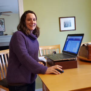 Trisha Blosser, development officer, at her high tech home standing desk. Photo credit: her boys