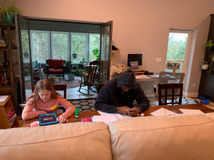 Chad Seibert, boys varsity basketball coach and PE teacher, shared a picture of home school at his house, including his daughter and Aviwe Mahlong, host son.