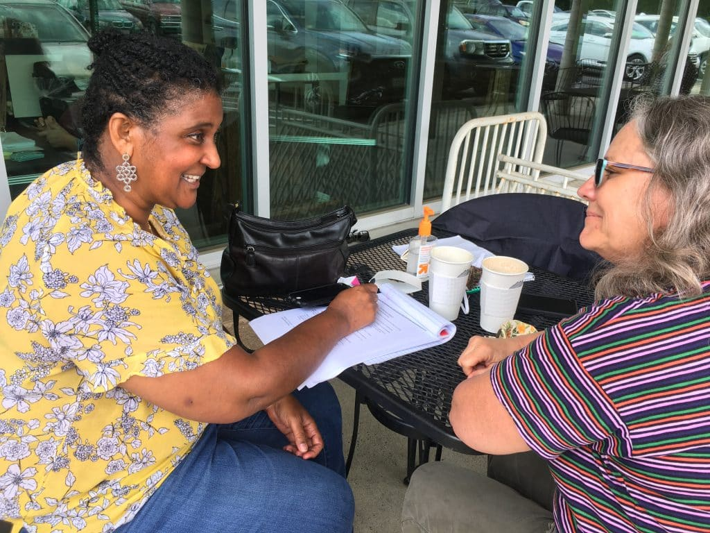 Debbie Katz, high school counselor, and Maria Archer, K-8 principal, plan for a meeting of the Racial Equity Working Group