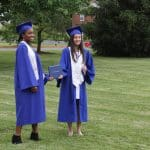 Commencement 2020. Virtue Adawe and Isabella Madrid