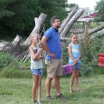 Tyler Kauffman with Sienna and Delaney check on progress on the fort.
