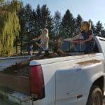 Shoveling topsoil for the bridge garden