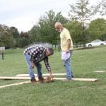 EMS dad Dwight Huyard (right) consults with Sam Petersheim, as they begin to build the outdoor stage.