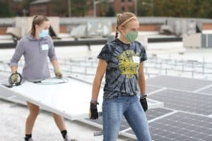 Sidney Rhodes'22 and Karla Hostetter '21, EMS Sustainablity club members at the solar barn raising