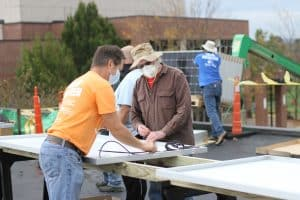 Jeff Heie, communty volunteer coordinator, and Earl Martin at the solar barn raising