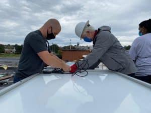 Everett Brubaker '10 and Tony Smith of Secure Futures at the solar barn raising