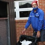 Kendal Bauman, faculty club sponsor, brings elementary school compost to the main collection bins each week.