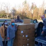 Staff at Capital Christian Fellowship unload MCC food boxes, provided by EMS. Pastors Glenn Kauffman and Akeia Haddox-Rosssiter on the right.