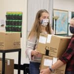 Halie Mast and Karla Hostetter move boxes for the National Honor Society food drive, fall 2020.