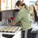 Student bakers preparing items for golfer goodie bags