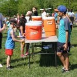 Eighth grade helps with games at elementary field day
